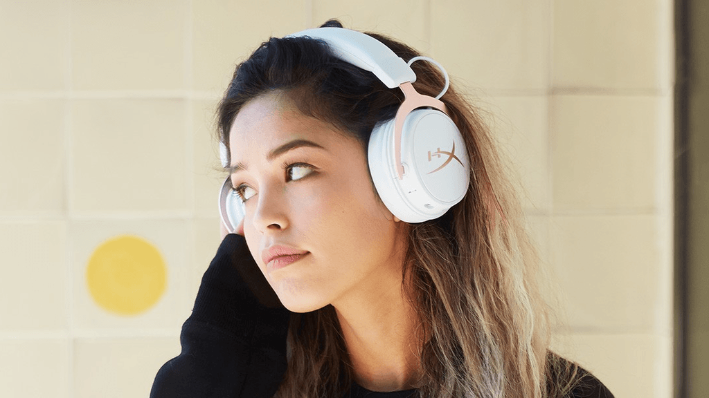 Promotional picture of a girl wearing the HyperX Cloud MIX, considered one of the best Bluetooth gaming headsets on the market.