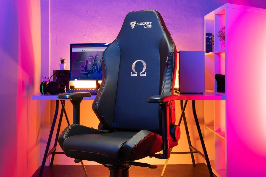 Picutre of a gaming room, with front and center a Secretlab Omega chair, which many consider one of the best gaming chairs out there.