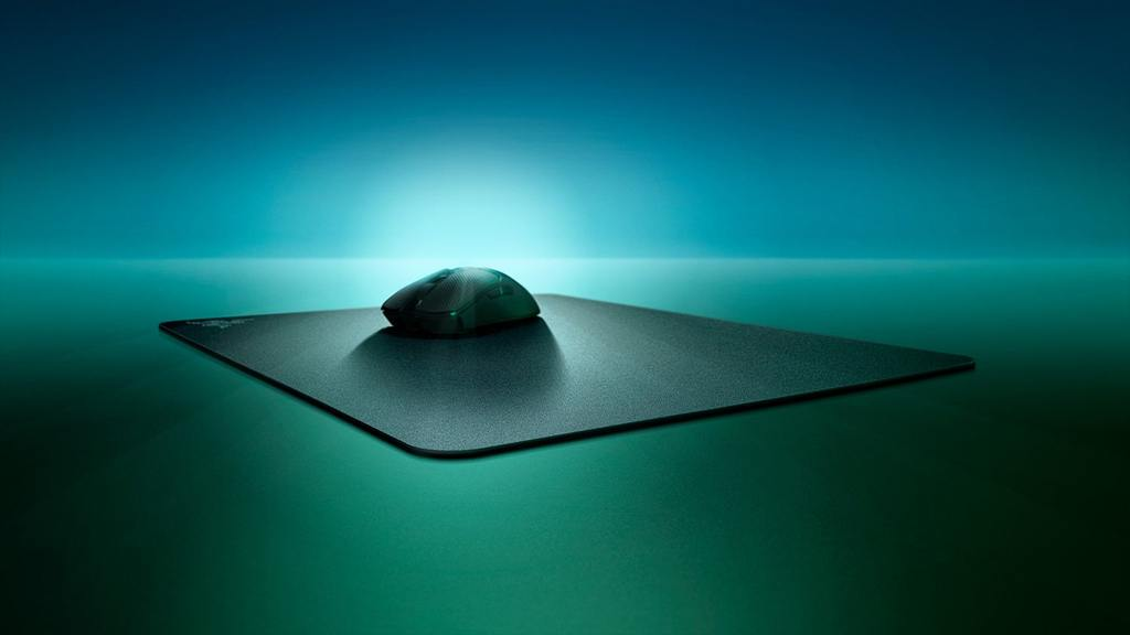 Illustration of a gaming mouse pad, accompanied with gaming mouse on top.