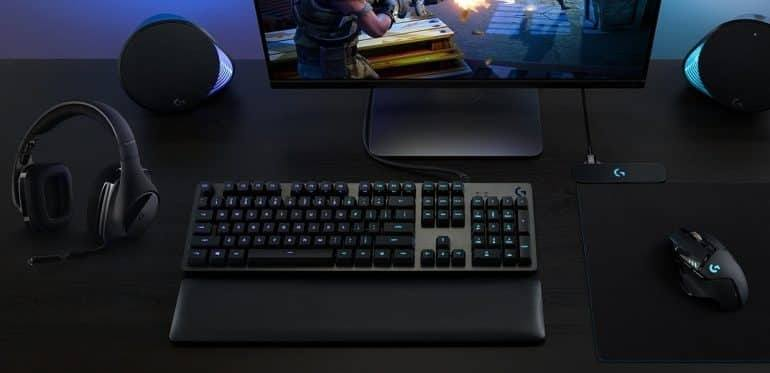 Some Logitech gaming peripherals on a desk, all synchronized through their RGB software.