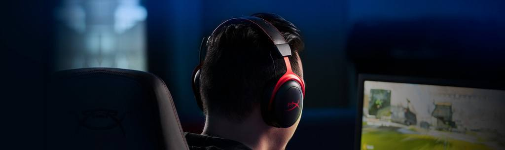 The HyperX Cloud II, one of the most popular analog gaming headsets, resting on a gamer's head.
