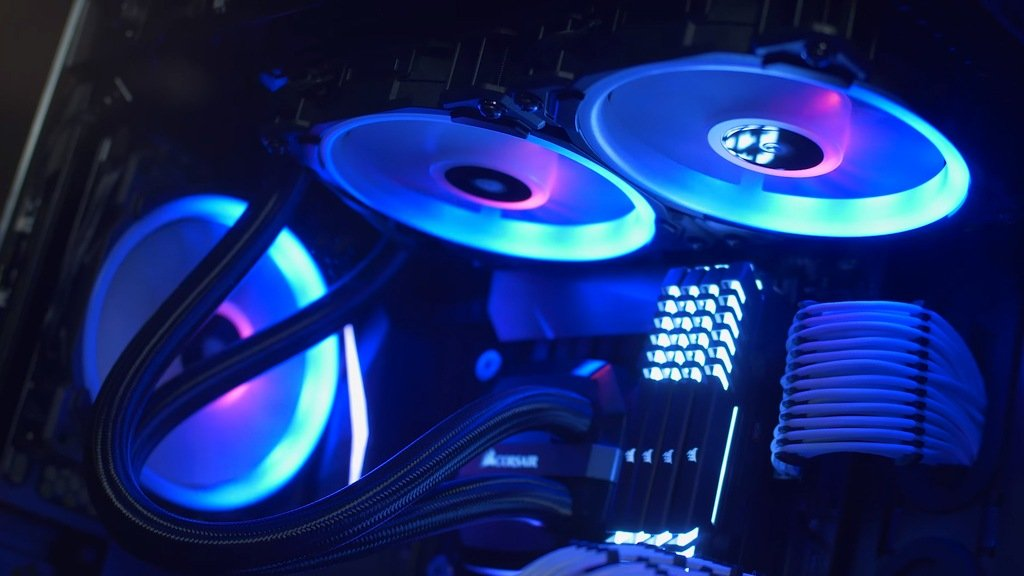 Picture of an exposed gaming PC, decked out with three Corsair LL120 fans, considered some of the best case fans for RGB enthusiasts.