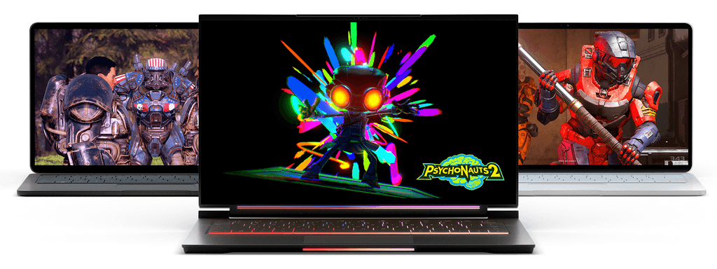 A trio of Windows 11 gaming laptops, each displaying a different title found in Xbox Game Pass.