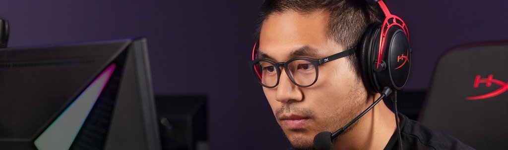 A gamer wearing gaming glasses and a headset.